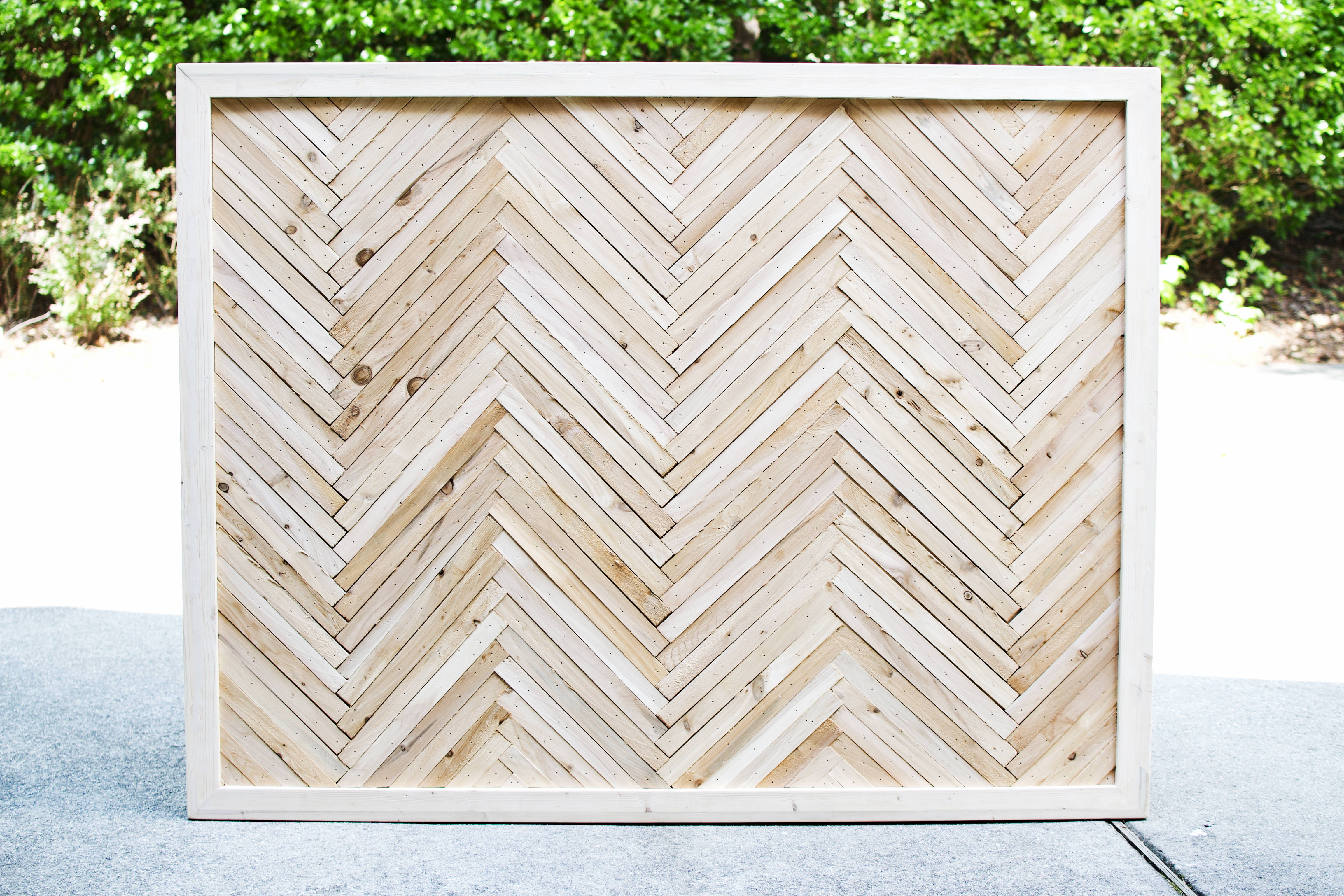 How to build a DIY herringbone headboard with wood shims