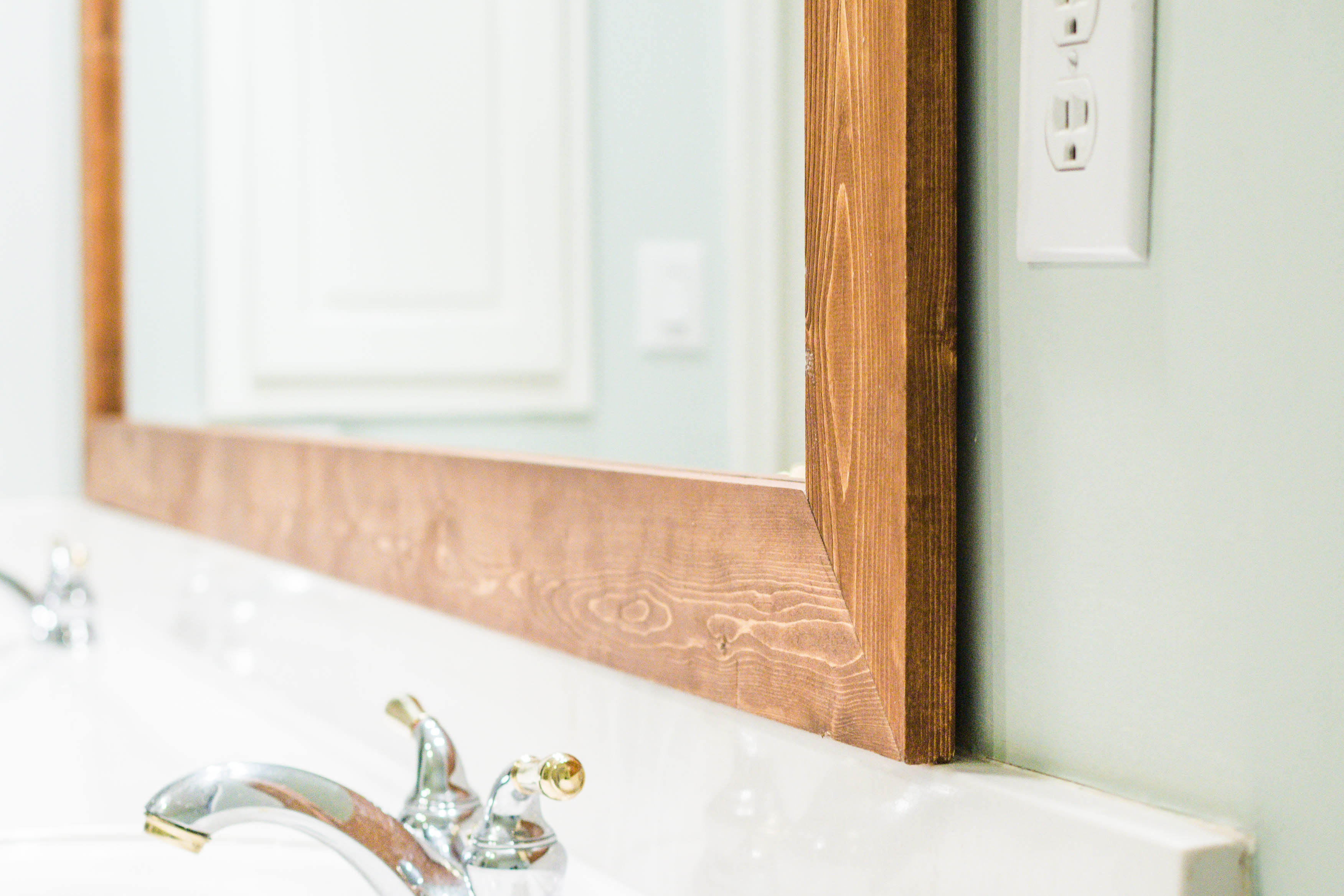 How To Diy Upgrade Your Bathroom Mirror With A Stained Wood